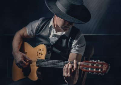 Man-Playing-Guitar-Studio-Colour-Portrait